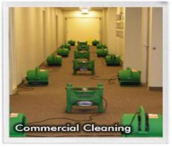 Dehumidifiers dry a commercial business floor