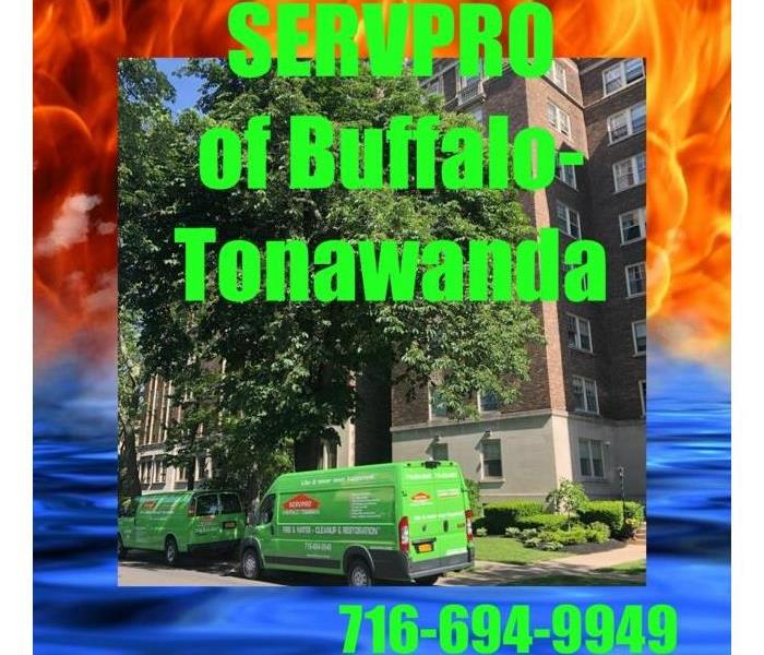Photo shows a SERVPRO van parked outside of a high rise apartment complex to clean up soot and water.
