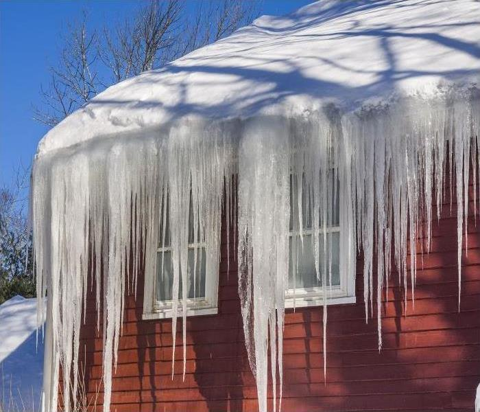 Ice dam forming on the side of a home