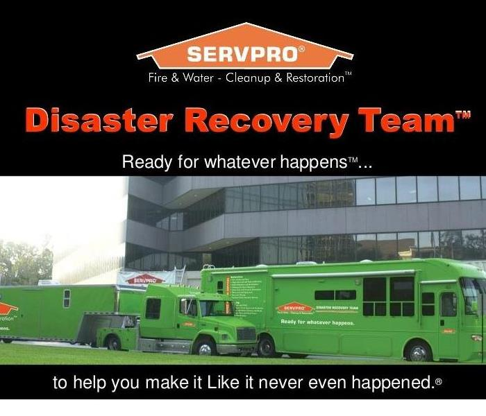 Photo shows tyhe orange SERVPRO house logo with several SERVPRO trucks responding to a large loss.
